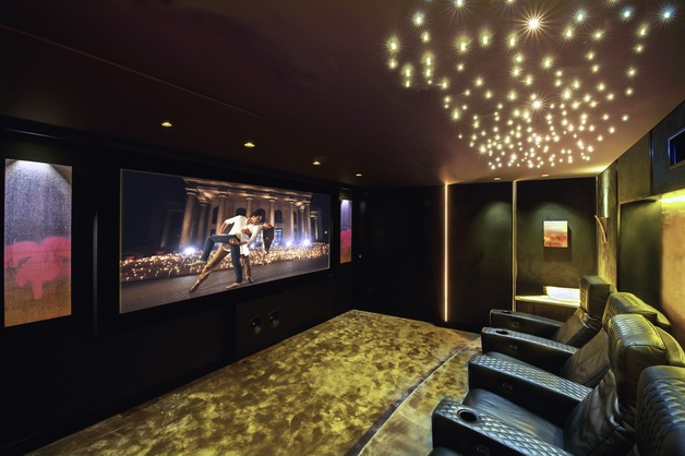 Illusion is a leading installer in Marbella Spain and was in need of modernising its flagship home cinema showroom. Working with architects and interior designers, Illusion drew from their experience in creating a luxurious  yet cozy surrounding for its 4K cinema. State of the art lighting solutions combined with Onyx and leather reflect the latest customer preferences on the coast.   The cinema itself had of course to be at reference level supporting Front LEFT / RIGHT / CENTRE Artcoustic 120-36SL with images, Artcoustic Spitfire Control 2 Sub and Artcoustic Diablo surround. Powered by Audiocontrol surround processor / amplifier the system sounds incredible. The latest SONY native 4K projector completed the installation offering stunning images.